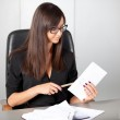 Portrait of a beautiful executive woman secretary at work while — Stock Photo #36524973
