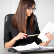Portrait of a beautiful executive woman secretary at work while — Stock Photo #36524975