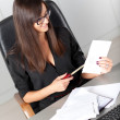 Portrait of a beautiful executive woman secretary at work while — Stock Photo