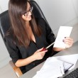 Portrait of a beautiful executive woman secretary at work while — Stock Photo #36524977