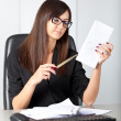 Portrait of a beautiful executive woman secretary at work while — Stock Photo #36524981