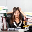 Stress on work.woman holding her head — Stock Photo