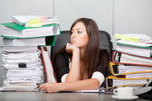 Beautiful woman looking dreamingly in the office — Stock Photo