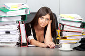 Beautiful woman over-worked in the office — Stock Photo