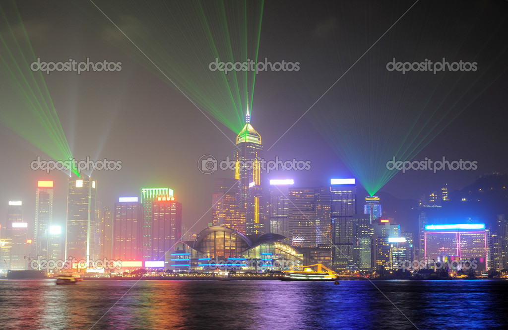 A Symphony of Lights is a synchronised building exterior decorative light and laser multimedia display, featuring 44 buildings on both sides of the Victoria Harbour  — Stock Photo #20276073