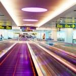 Travellators at airport — Stock Photo