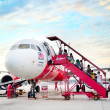 AirAsia boarding plane — Stock Photo