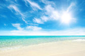 Beautiful beach and tropical sea — Stock Photo