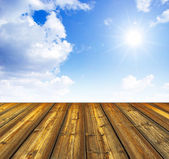 Blue sky and wood floor background — Stockfoto