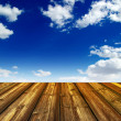 Blue sky and wood floor background — Stock Photo