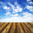 Stock Photo: Blue sky and wood floor background