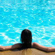 Woman sitting in swimming pool — Stock Photo