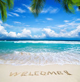 Welcome written in beach — Stockfoto