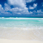 Word Relax on sand beach — Stock Photo