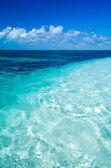 Blue sea under clouds sky — Stock Photo