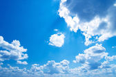 Blue sky background with a tiny clouds — Stock Photo