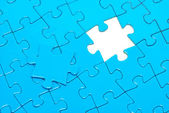 Blue puzzles for background — Stock Photo