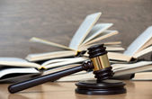 Wooden gavel and books  — Stock Photo