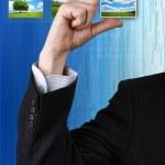 Businessman holding a photo — Stock Photo #18047135