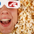 Foto de Stock  : Young guy in the popcorn