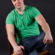 A young man sitting on a chair — Foto Stock