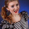 Stock Photo: Beautiful young girl in a striped blouse