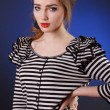 Foto Stock: Beautiful young girl in a striped blouse