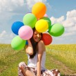 Happy young woman and colorful balloons — Foto de Stock