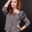 Beautiful young girl in a striped blouse — Stockfoto #18043439