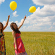 Happy young women and colorful balloons — Stock Photo #18043973