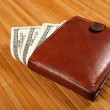 Brown purse on wooden table. — Stock Photo