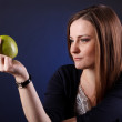 Portrait of an attractive young girl with an apple — Stock Photo