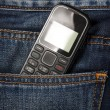 Mobile phone in pocket jeans — Stock Photo #18044029