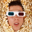 Young guy in the popcorn — Stock Photo #18044105