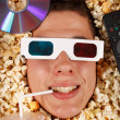 Stock Photo: Young guy in the popcorn