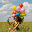 Happy young woman and colorful balloons — Stock Photo #18044233
