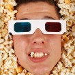 Young guy in the popcorn — Stockfoto #18044315