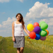 Happy young woman and colorful balloons — Stock fotografie #18044385