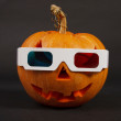 Orange halloween pumpkin in 3d glasses — Stock Photo