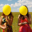 Happy young women and colorful balloons — Stock fotografie #18044513