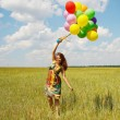 Happy young woman and colorful balloons — Stock Photo #18044515