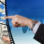 Businessman pressing on the film. — Stock Photo
