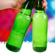 Green bottle. disco background — Stock Photo #18044587