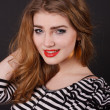 Beautiful young girl in a striped blouse — Stock Photo #18044601