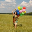Happy young woman and colorful balloons — Stock Photo #18044631