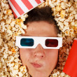 Young guy in the popcorn — Stock fotografie #18044693