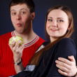Young couple is eating apple — Stock Photo #18044803