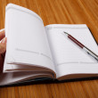 Notebook on wooden table — Stock Photo