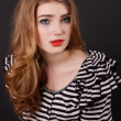 Beautiful young girl in a striped blouse — Photo