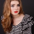 Beautiful young girl in a striped blouse — Stockfoto